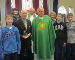 Phil with his sister, daughter, 3 grandsons and Frs O'Leary and Harlow